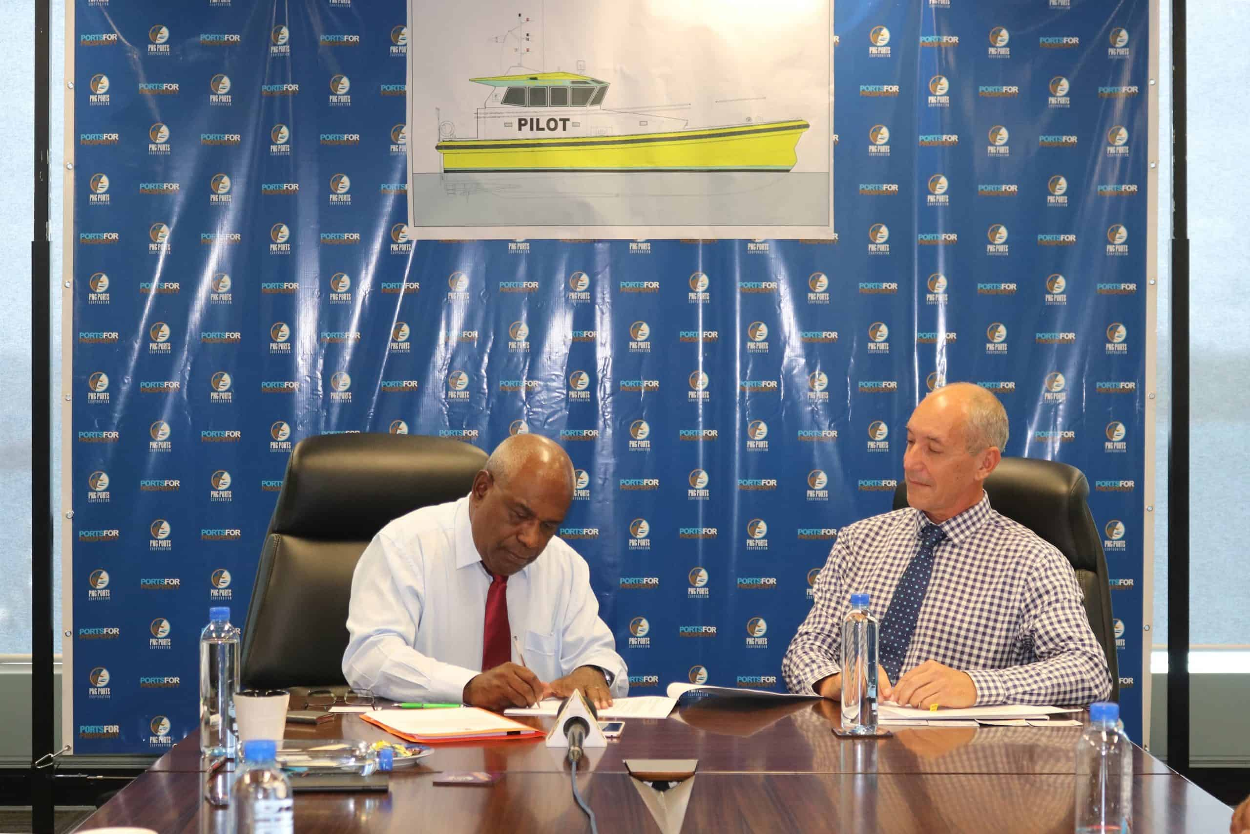 PNG Ports Corporation Chairman Mr Kepas Wali and Norman R. Wright & Sons Managing Director Tony Riek signing the Pilot Boat contract-min